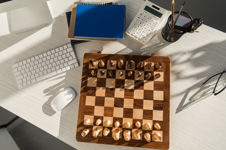 flat lay chess board at workplace with computer keyboard Stok Fotoğraf