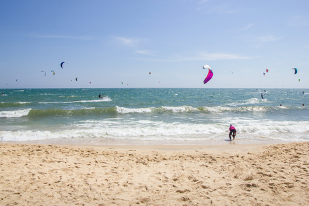 people on paragliders at beautiful sandy seashore, Vietnam, Mui Ne