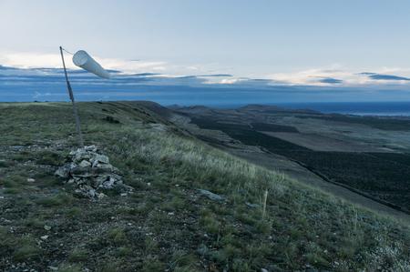 Beautiful mountainous landscape with windsock waving in Crimea, Ukraine.