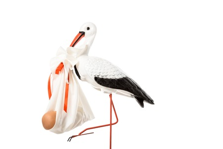 Decorative stork holding baby nappy with doll isolated on white Stock Photo - 112758693