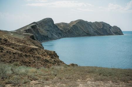 Scenic calm seashore with Crimean mountains ridge, Ukraine.