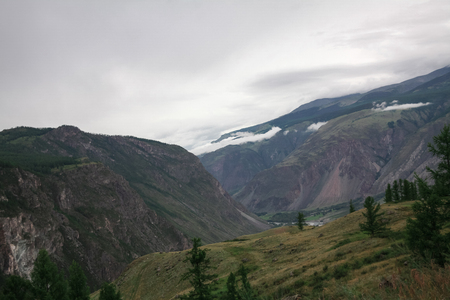 Panoramic view of majestic mountains and cloudy sky, Altai, Russia Stock Photo - 112759028