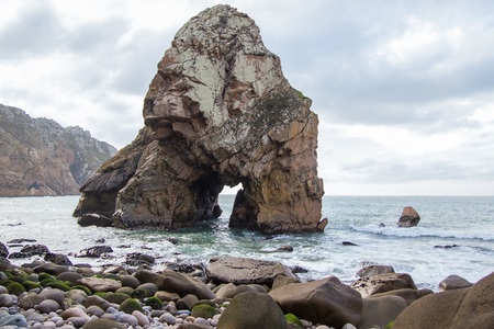 Amazing landscape with rock in the form of an arch in the sea, Cabo da Roca, Portugal