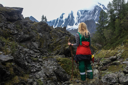 Back view of woman standing in mountains, Altai, Russia 版權商用圖片