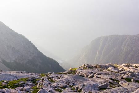 Rocks and beautiful mountains at foggy sunrise, alps, Switzerland