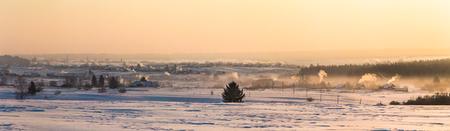 Beautiful winter landscape and village at countryside at sunset, Kazan region, Russia