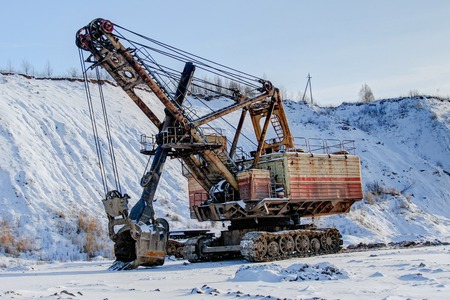 Industrial digger and snow covered territory, Ruba, Belarus 스톡 콘텐츠