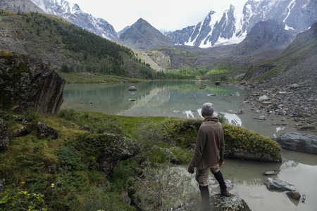 Back view of man looking at mountains in Altai, Russia