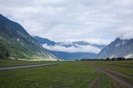 Scenic view of mountains, valley and cloudy sky, Altai, Russia