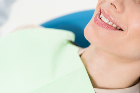 Smiling woman at check-up in modern dental clinic Imagens