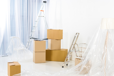 ladders and boxes in new empty apartment Stock Photo