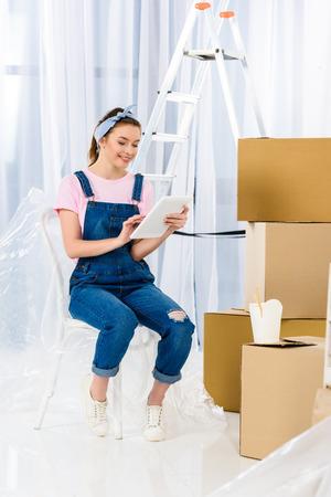 girl using tablet after moving to new home