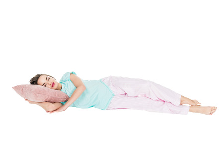 girl in pajamas sleeping on pillow isolated on white