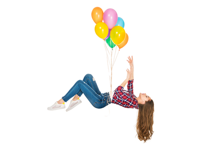 young woman levitating with colorful balloons isolated on white