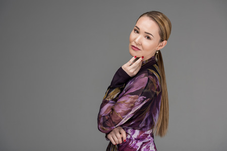 beautiful kazakh woman posing and looking at camera isolated on grey Stok Fotoğraf - 112769552