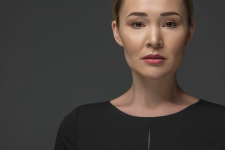 portrait of beautiful kazakh woman looking at camera isolated on grey Stok Fotoğraf
