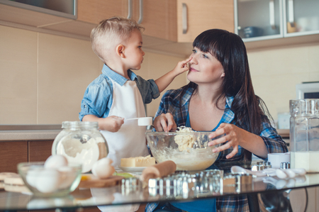 adorable son touching mother face in kitchen Standard-Bild - 112769867