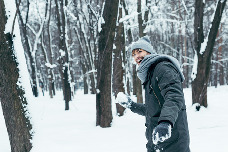 portrait of happy young man playing with snow in winter park Zdjęcie Seryjne - 112762221