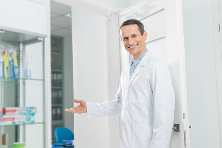Doctor inviting patient to modern clinic
