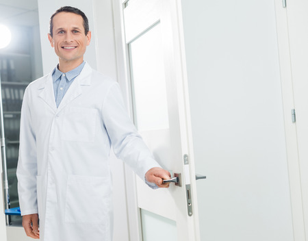Doctor welcoming patient in modern clinic Stock Photo