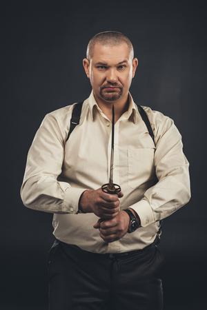 Yakuza member with tanto knife looking at camera 写真素材