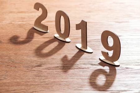 2019 date made of plywood numbers with shadows on wooden table