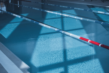 deep calm blue water with shadows in swimming pool Stock Photo