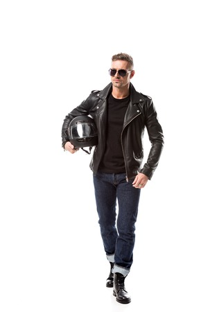 confident man in leather jacket and sunglasses holding motorcycle helmet isolated on white Stok Fotoğraf