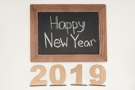top view of happy new year text on chalk board with 2019 date made of plywood isolated on white 스톡 콘텐츠
