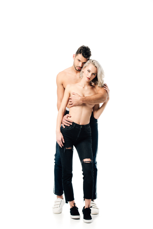 handsome man holding topless woman in passionate embrace isolated on white