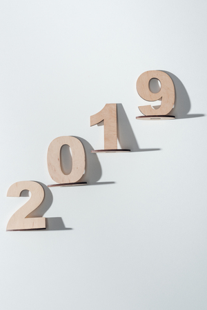 top view of 2019 date made of wooden numbers on white background