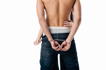 cropped view of woman touching handcuffed man isolated on white Stock Photo