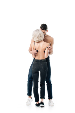 shirtless man unzipping bra of blonde woman isolated on white