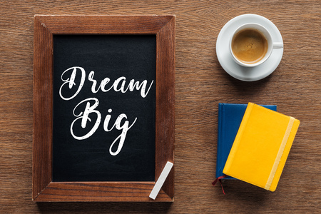 top view of chalk board with 'dream big' lettering on wooden background Stok Fotoğraf
