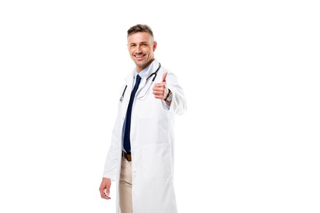 doctor looking at camera and doing thumb up sign isolated on white