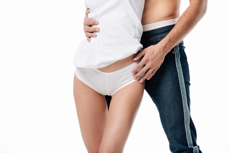 vue recadrée de couple hugging isolated on white
