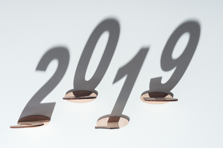 top view of wooden numbers with 2019 shadow on white background Reklamní fotografie