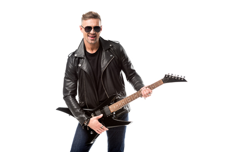 handsome adult man in leather jacket holding electric guitar isolated on white