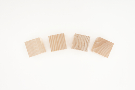 top view of four wooden blocks isolated on white 版權商用圖片