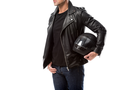 cropped view of man in leather jacket holding motorcycle helmet isolated on white