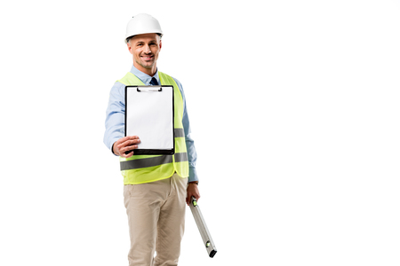 smiling engineer holding clipboard with blank sheet and spirit level isolated on white Stock Photo - 112991742