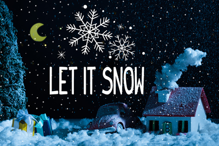 """close-up shot of toy car with christmas gifts and house covered with snow at night, with """"let it snow"""" lettering with snowflakes"""