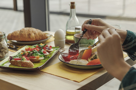 cropped shot of person eating healthy tasty breakfast Stock Photo