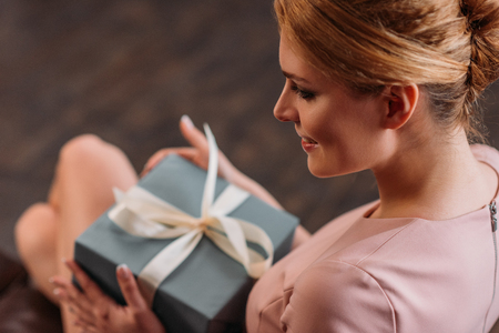 close-up shot of beautiful young woman with valentines day gift