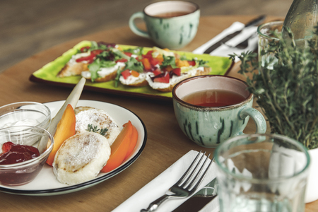 close-up view of delicious healthy breakfast with tea on table Stock Photo