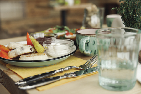 close-up view of utensils, cutlery and healthy breakfast on table
