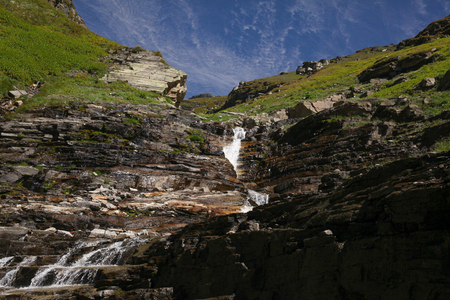 beautiful waterfall on scenic rocks in Indian Himalayas, Rohtang Pass