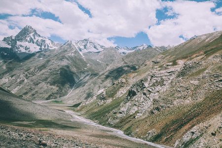 beautiful mountain valley and majestic rocky snow capped peaks in Indian Himalayas, Ladakh region