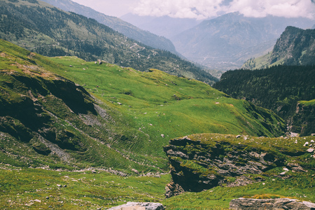 majestic rocky mountains covered with green grass and moss in Indian Himalayas, Rohtang Pass 写真素材