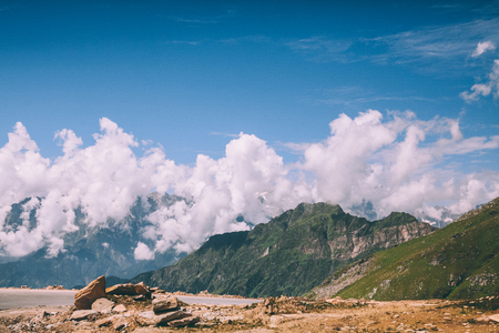 beautiful scenic mountain landscape and blue sky with clouds in Indian Himalayas, Rohtang Pass 写真素材